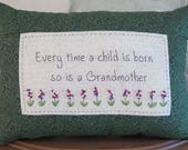 Every time a child is born Embroidered Pillow