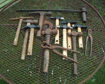 Large lot of 10 Blacksmith's hammers and one wire bound tool, two pliers, lot00