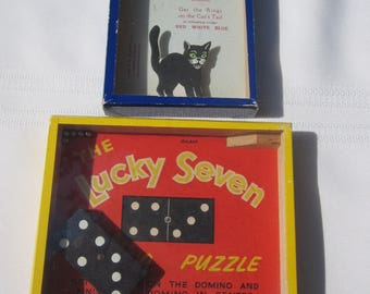 Two Vintage Puzzles The Lucky Ringtail Cat/ The Lucky Seven Domino Puzzle by R. Journet & Co.