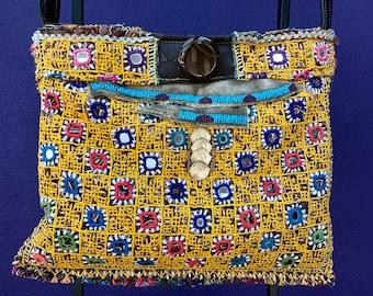 Unique handmade ethnic boho chic rare vintage banjara tribal fabric purse with distressed elk skin back and embellished front
