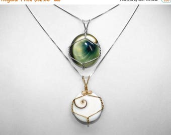 Reversible Eye of Shiva Shell Pendants in Silver and Gold