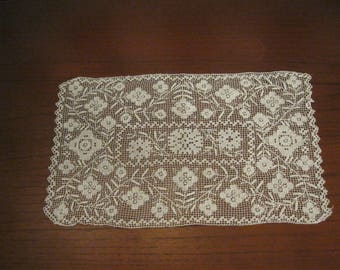 Delicate net darning in a rectangular doily