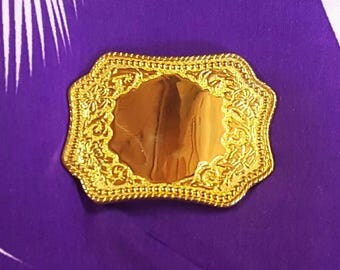 """Buckle Brass engraved  western style very shiny blank center  2.25"""" tall 3"""" wide."""
