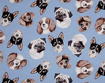 Tossed Dog Faces on Blue from Timeless Treasures - 100% cotton