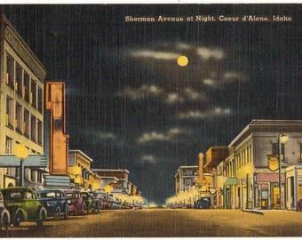 Linen Postcard, Coeur d'Alene, Idaho, Sherman Avenue at Night, 1950