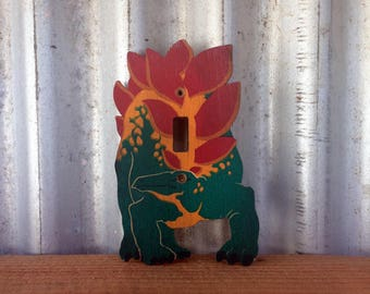 Switchsaurus -- Wooden light switch cover decorated to resemble a stegosaurus