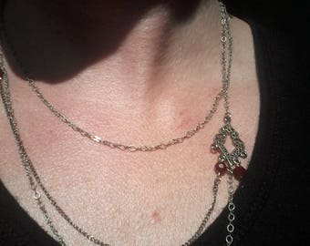 Layered silver necklace, with red swarovski crystals