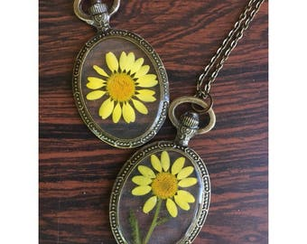 Preserved Yellow Daisy enclosed within Bronze Oval Pendant Necklace