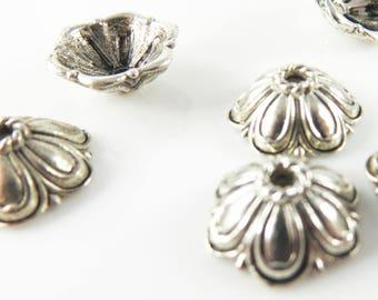 Silver tone bead caps