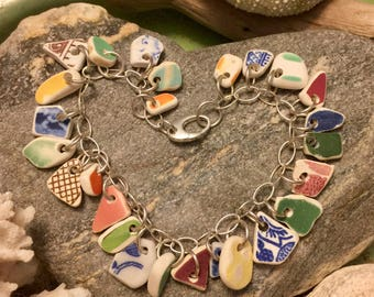 Sea glass pottery jewelry- 25 pieces of colored sea glass pottery on a sterling silver bracelet