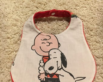 Peanuts gang snoopy and Charlie brown baby bib