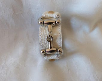 leather strap and silver metal horse bit