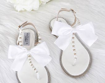 Wedding sandals etsy women pearls wedding sandals white patent pearlrhinestones flat sandal with oversized satin bow junglespirit Choice Image
