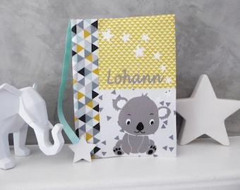 Protège carnet de santé personnalisable koala , tissu triangle et son marque page étoile
