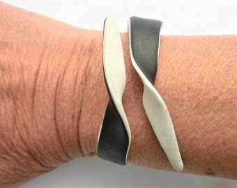 Black and white bracelet/ Fimo (polymer clay) flexible cuff/ two sides 2 colors/ strip with 2 twisted points/ can bend open to put on