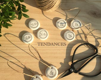Has 10 round tags ceramic hanging or a stick