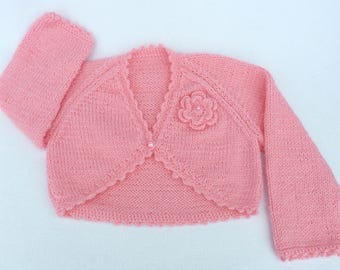 Baby sweater. Baby girl hand knitted sugar pink baby bolero cardigan to fit 6 to 12 months