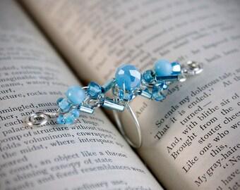 Shiny light blue glass statement ring