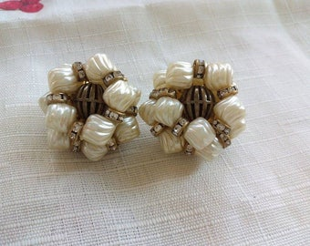 Large unsigned filigree and faux pearls clip on earrings
