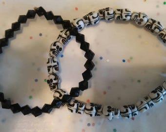 Set of two bracelets, skulls and black glass