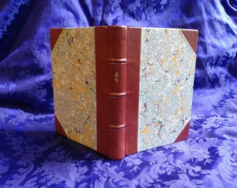 Halfbound journal with gilding and slipcase.