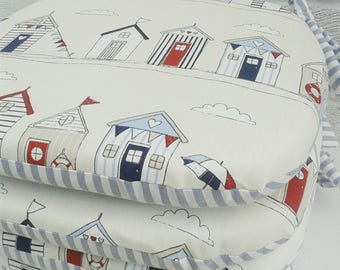 Seat pad in Clarke and Clarke Beach Hut fabric with blue stripe. Ties on chair cushions. Kitchen seat pads.