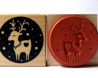 Stamp around reindeer in snow Christmas