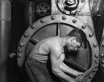 Power house mechanic working on steam pump, Lewis Hine, 1920