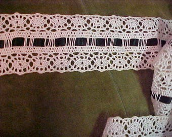 Vintage White Lace with Bl Rilbbon threaded thru.   2 yards and 21 inches wide.   #3268