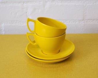 Vintage Melaware cups and saucers in yellow