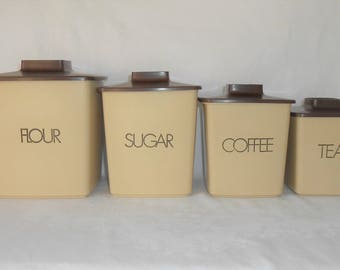 Nesting 1970's Tan & Brown Plastic Canister set
