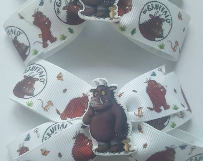 Featured listing image: The Gruffalo Hair Bows x 2 Pinwheel bows with aligator clups and resin embellishment