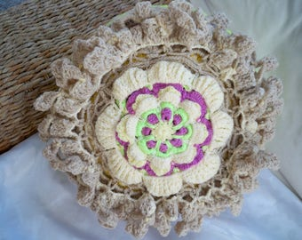 Pillow with crochet flower realized