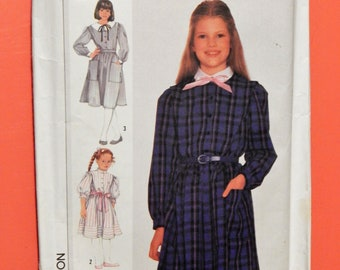 Vintage little girls' shirt dress pattern Simplicity 7110 Front button dress pattern with collar variations Uncut Sizes 7 and 8
