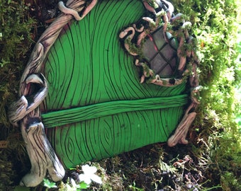 Green moss fairy door