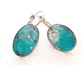 Earrings.  leverback oval cabachon