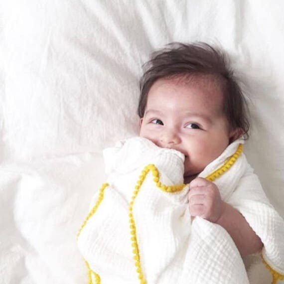 Light Weight White Swaddle With Yellow Pom Poms