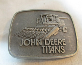 John Deere Titans belt buckle with corn head combine, advertising 1978 Moline, Illinois