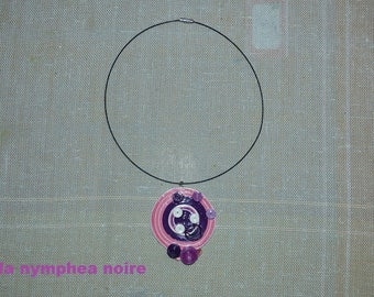 crew neck with pink, purple tones quilling pendant