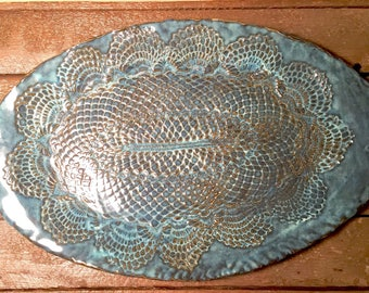 Large handbuilt pottery platter in blue with lace impression