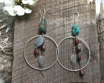 Turquoise stone hoop earrings with repurposed rosary beads, silver wings and religious medallion Mismatched earrings