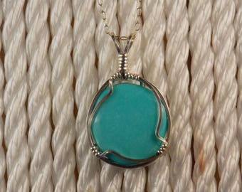 PT#473SS Turquoise pendant wire wrapped with solid sterling silver wire.