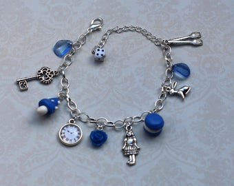"Blue bracelet charm ""Alice in Wonderland country"""