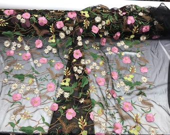 Pink multi color lust design embroider on a black mesh-prom-nightgown-decorations-sold by the yard.