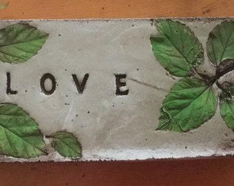 "10 1/2 x 4 concrete ""Love"" garden stone"
