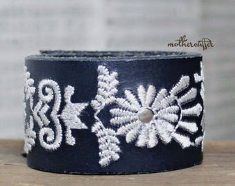 CUSTOM HANDSTAMPED wide black leather cuff with white stitching by mothercuffer