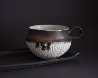 Tea/coffee cup with bronze and lava glaze, handmade wheel thrown porcelain, textured, elegant and minimalist