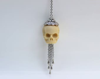 Human skull necklace in silver
