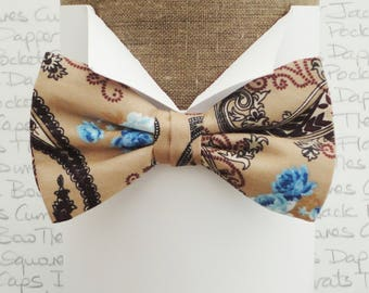 Bow ties for men, black paisley and blue roses on a coffee background