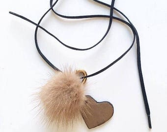 Leather collar with pompom